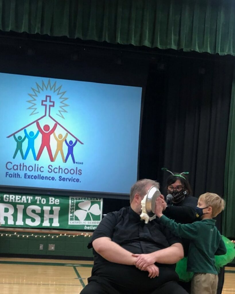 Catholic Schools Week-It's a WRAP! And Fr. David was the lucky winner for pie-face!